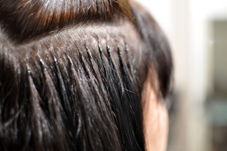While the hair extension tip is softened from the laser, it is gently rolled onto the clients hair. The finished bond is about the size and shape of a grain of rice.